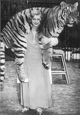 Woman lifts a tiger
